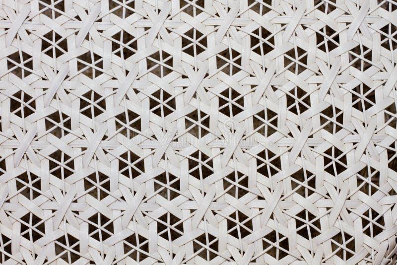 Weave pattern. A chair white basket weave pattern royalty free stock photo