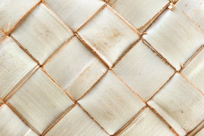 Weave pattern of palm leaves. Zigzag interlocking of palm leaves stock images