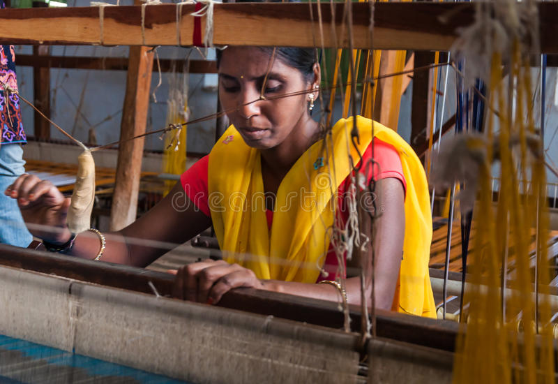 Weavers. Weaving cotton sarees in a village in India