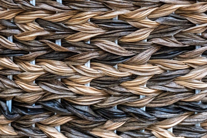 Weaving from a colored vine. handmade wickerwork pattern.  stock photo