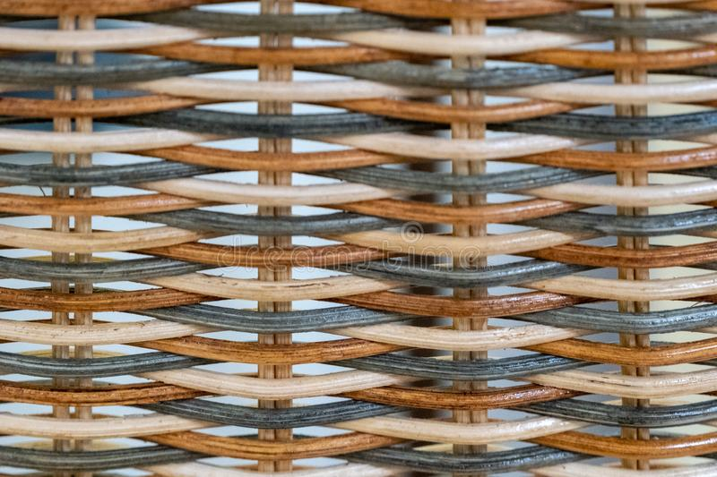 Weaving from a colored vine. handmade wickerwork pattern.  royalty free stock image