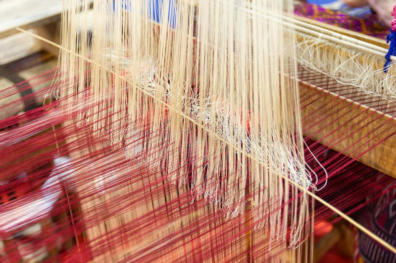 Weaving equipment Household weaving - Detail of weaving loom for homemade silk royalty free stock photos