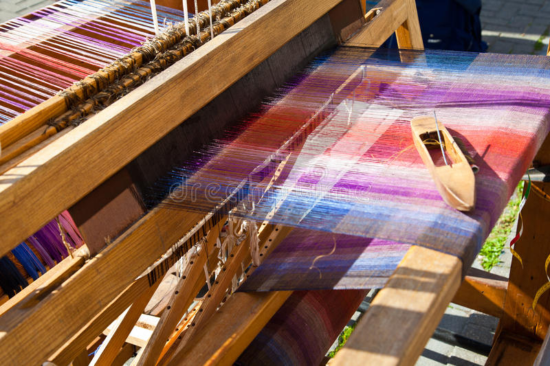 Weaving loom. Old weaving loom and shuttle stock photos