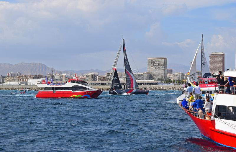 Scallywag Dodging Between The Spectator Boats Volvo Ocean Race Alicante 2017 stock photography