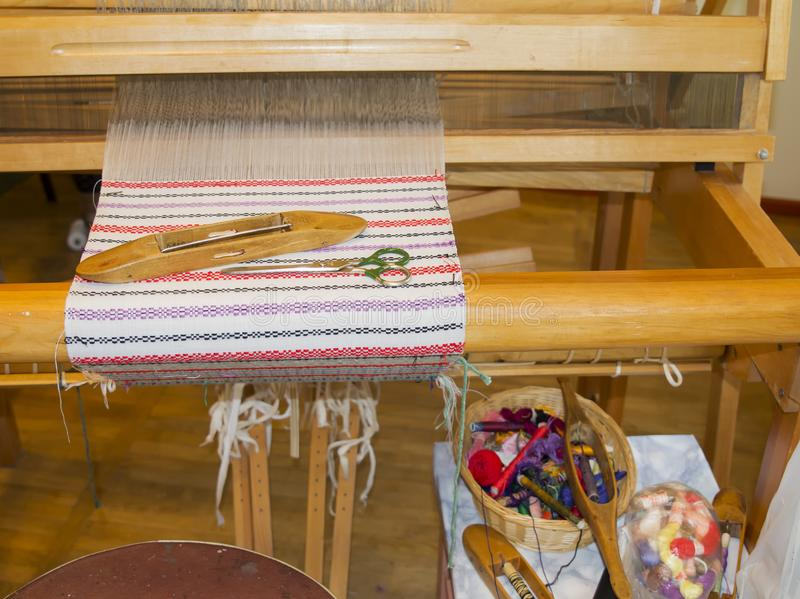 Weaving process with wooden looms ,handmade tablecloth royalty free stock images