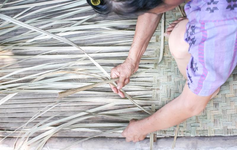 Weaving reed mat , handmade thai style stock photography