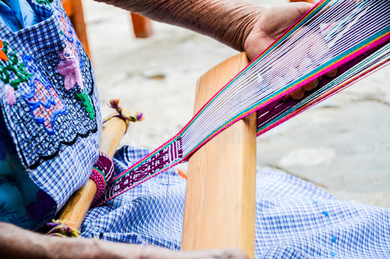 Weaving technique, Jalietza, Oaxaca, Mexico. 18 th May 2015. Intricate weaving and embroidery technique on waist loom royalty free stock photos