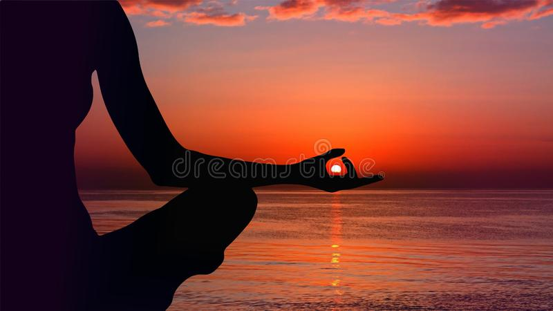 Girl silhouette, meditation at sunset red clear sky royalty free stock photography