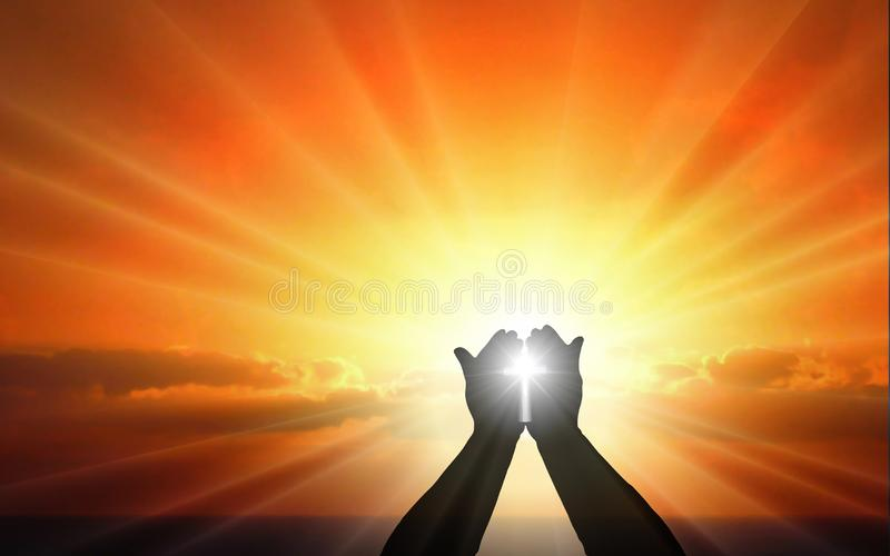 Human hands with cross in palm in sunset rays of light. Human hands open palm up worship, against sunset sky.. Bless God Helping Repent, Easter, Mind Pray royalty free stock images