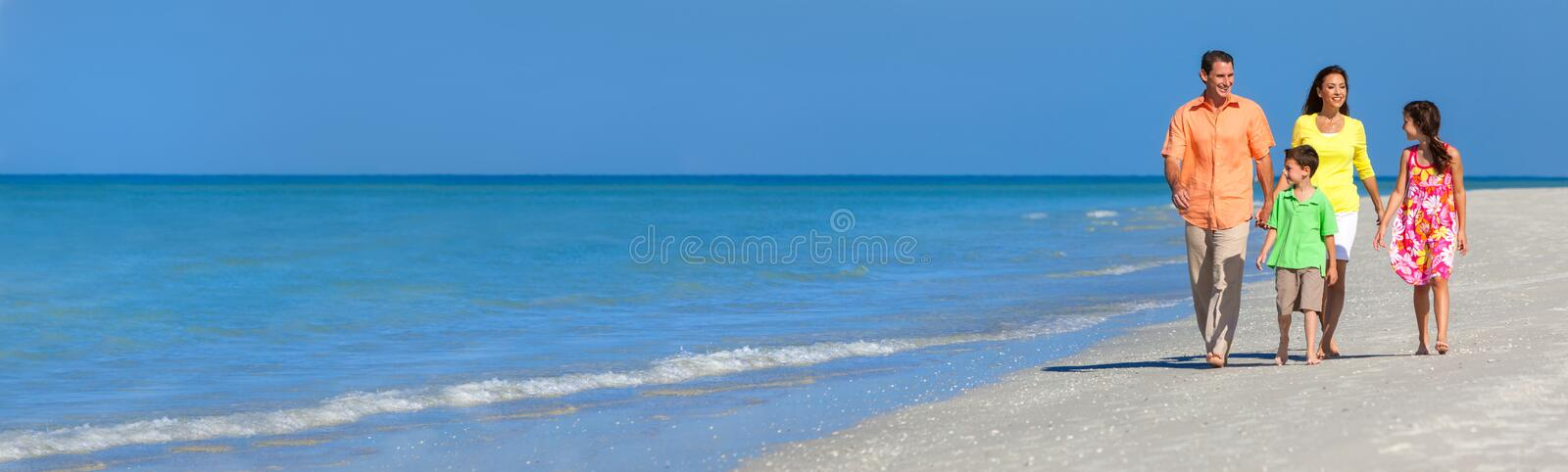 Web banner panoramic happy family of mother, father and two children, son and daughter, walking on a beach royalty free stock photos
