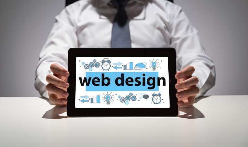 Web design concept. Businessman showing digital tablet with web design concept sketch stock photography