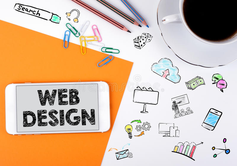 Web design concept. Mobile phone and coffee cup on a white office desk stock image