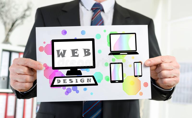 Web design concept shown by a businessman. Paper showing web design concept held by a businessman stock photos