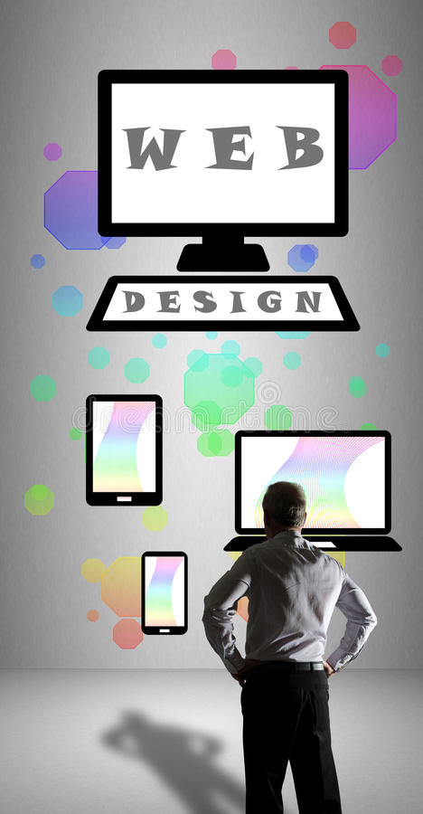 Web design concept watched by a businessman. Businessman watching a web design concept drawn on a wall royalty free stock photos