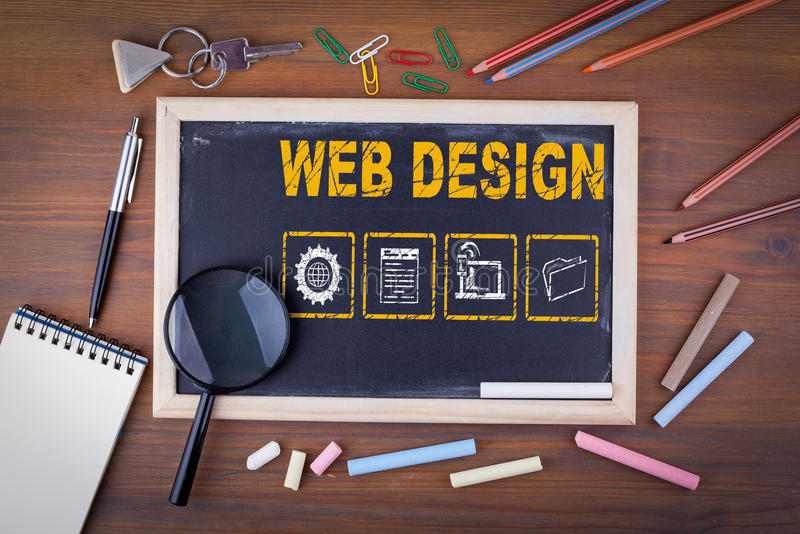 Web Design concept. On a wooden table chalk board stock photo