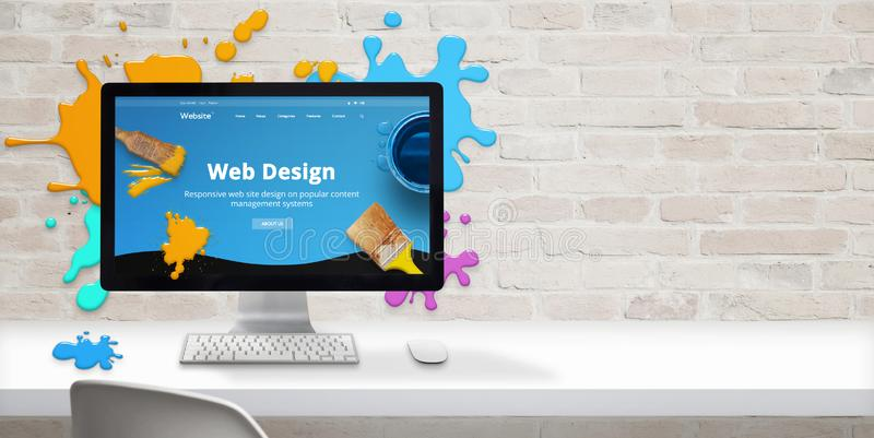 Web design studio concept with modern web site teme and web design text on computer display surrounded by color drops. Free space beside on brick wall for text stock photography