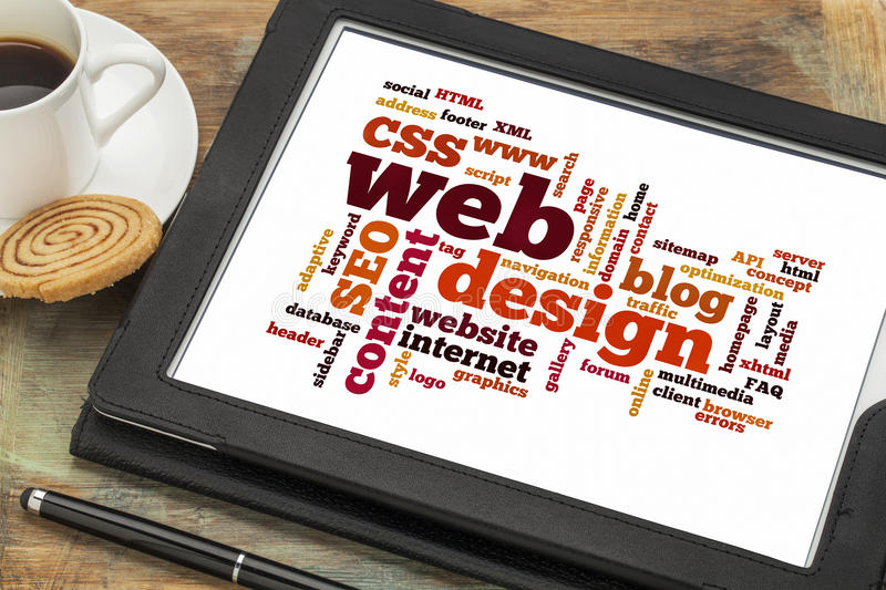Web design word or tag cloud. Cloud of words or tags related to web or website design on a digital tablet with a cup of coffee
