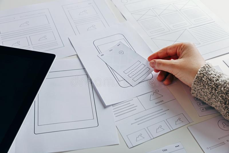 Web designer creating mobile responsive website stock photography