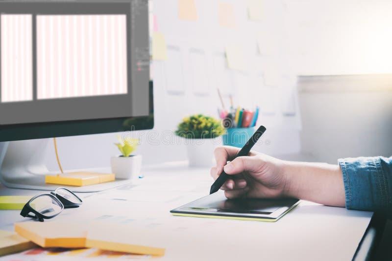 Web designer, UX UI designer working to design screen. Web designer, UX UI designer planning application for mobile phone. Responsive web desingn and mobile royalty free stock image