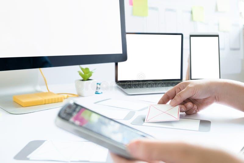 Web designer, UX UI designer working to design screen. Web designer, UX UI designer planning application for mobile phone. Responsive web desingn and mobile stock photos