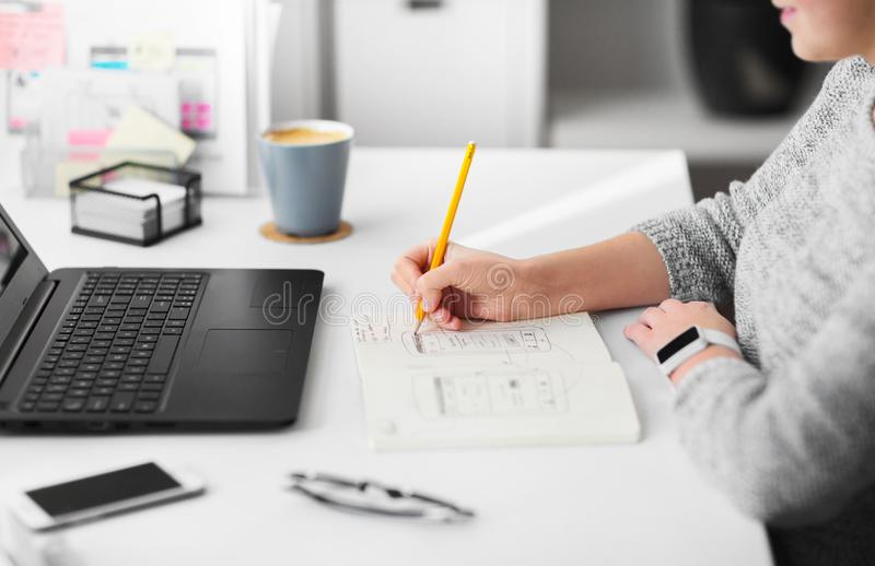 Web designer working on user interface at office stock photo
