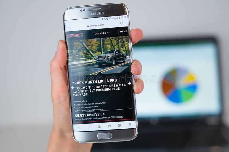 Web site of GMC company on phone screen royalty free stock photo