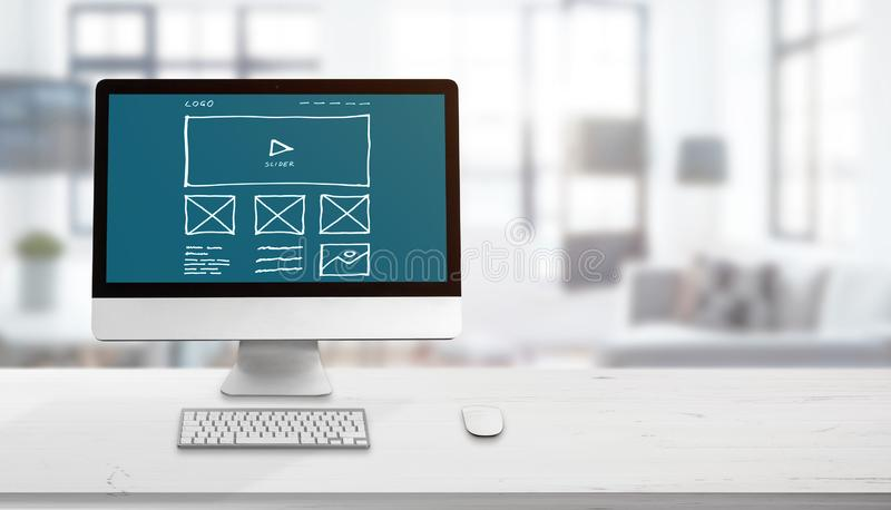 Web site sketch on computer display. Concept of web design studio. Copy space beside for promo text royalty free stock images