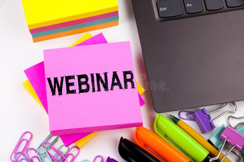 Webinar text in the office with surroundings such as laptop, marker, pen, stationery, coffee. Business concept for Online Training stock image