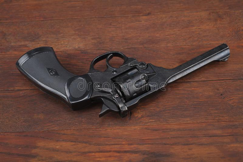 Webley Mk IV Top-Break Revolver service pistol for the armed forces of the United Kingdom, and the British Empire and Commonwealth. On wooden table stock photo