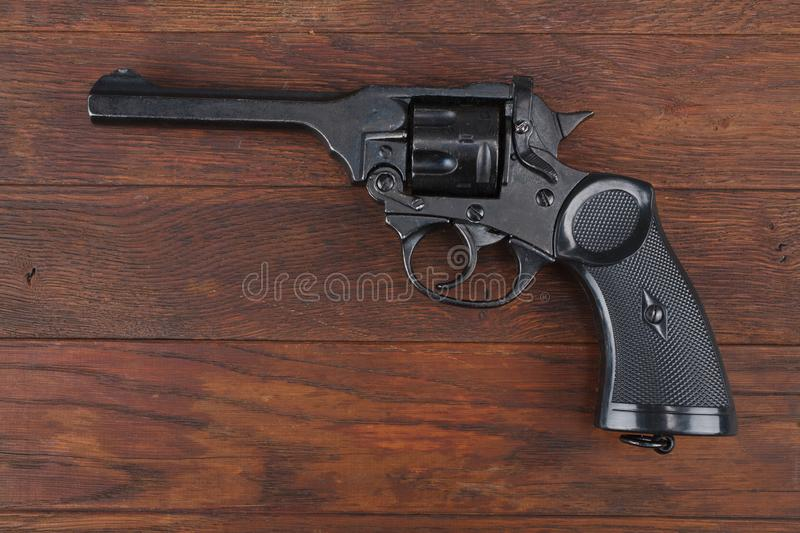 Webley Mk IV Top-Break Revolver service pistol for the armed forces of the United Kingdom, and the British Empire and Commonwealth. On wooden table stock images