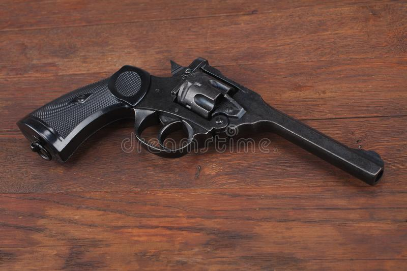 Webley Mk IV Top-Break Revolver service pistol for the armed forces of the United Kingdom, and the British Empire and Commonwealth. On wooden table royalty free stock images