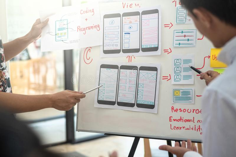 Website designer development UI/UX desing about sketched notes wireframe layout mobile application project. User experience stock image