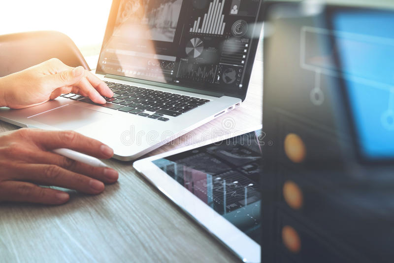 Website designer working digital tablet and computer laptop with stock image