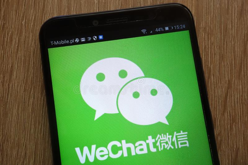 WeChat logo displayed on a modern smartphone royalty free stock photos