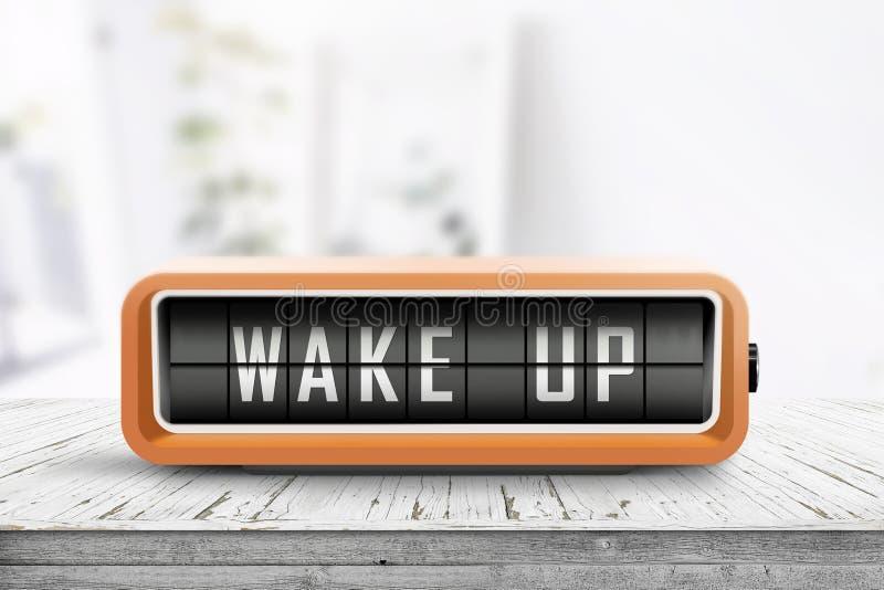 Wecke den Wecker auf einem Tisch in einem hellen Raum auf lizenzfreie stockfotos