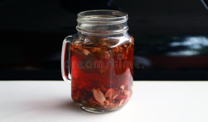 Wedang Uwuh. Traditional herb drink from Jogjakarta, Indonesia. Contains a variety of leaves: cinnamon, nutmeg and cloves leaves. Another ingredient is wood royalty free stock photos