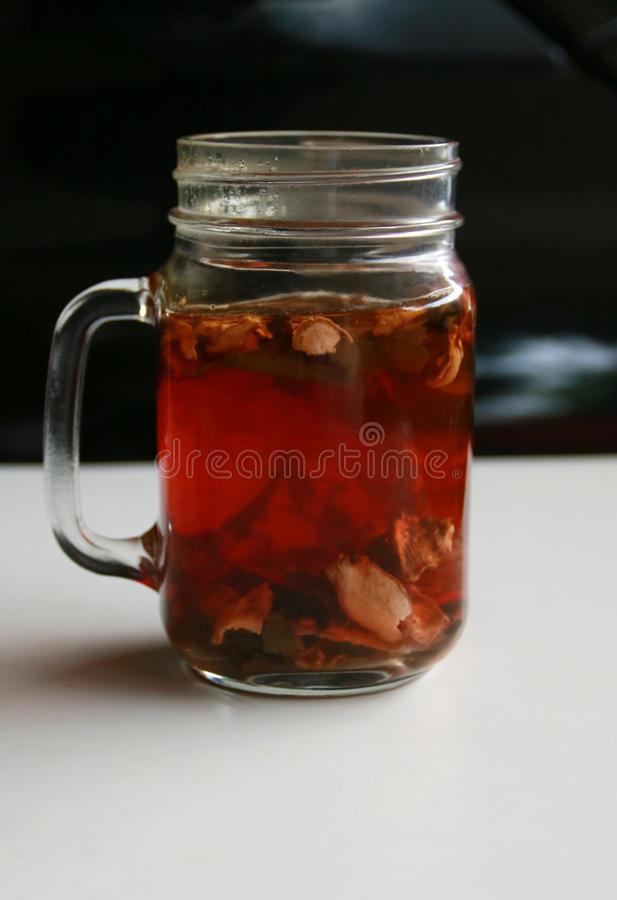 Wedang Uwuh. Traditional herb drink from Jogjakarta, Indonesia. Contains a variety of leaves: cinnamon, nutmeg and cloves leaves. Another ingredient is wood royalty free stock images