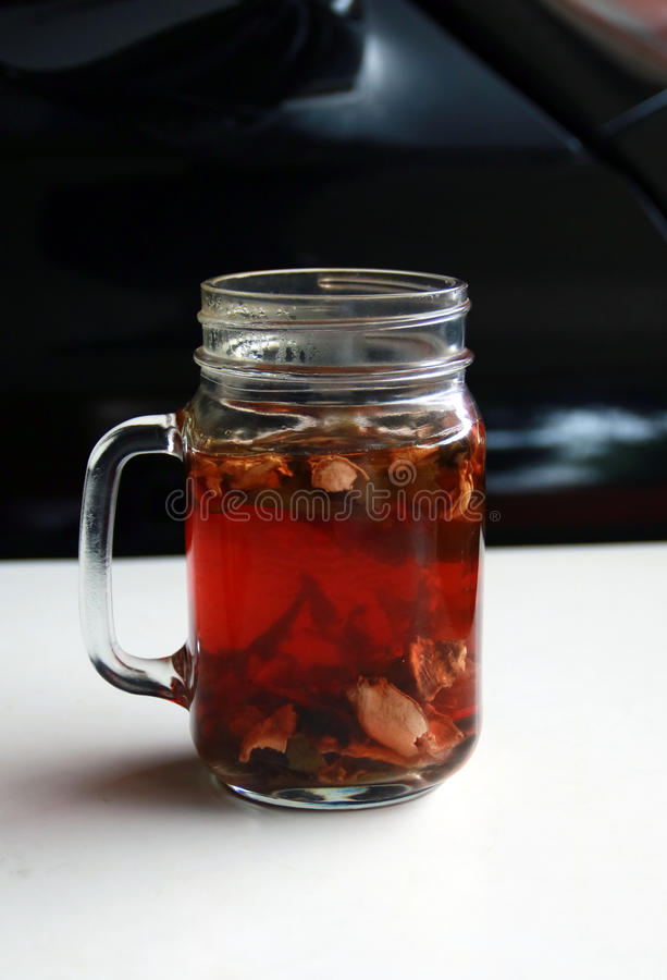 Wedang Uwuh. Traditional herb drink from Jogjakarta, Indonesia. Contains a variety of leaves: cinnamon, nutmeg and cloves leaves. Another ingredient is wood stock image