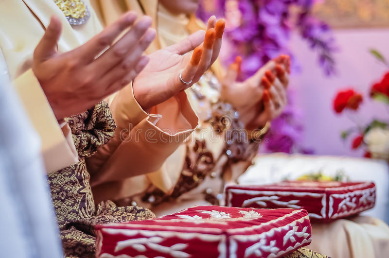Download Wedded Couple's Hands Praying Stock Photo - Image: 30553104