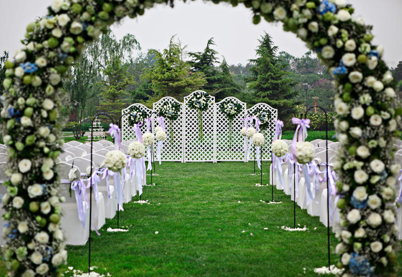 Wedding 1. Flower gate and chairs in a wedding,lilly and blue ribbon tied on the back of chairs