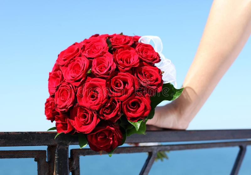 Wedding. Bride's rore bouqet in the hand stock photo