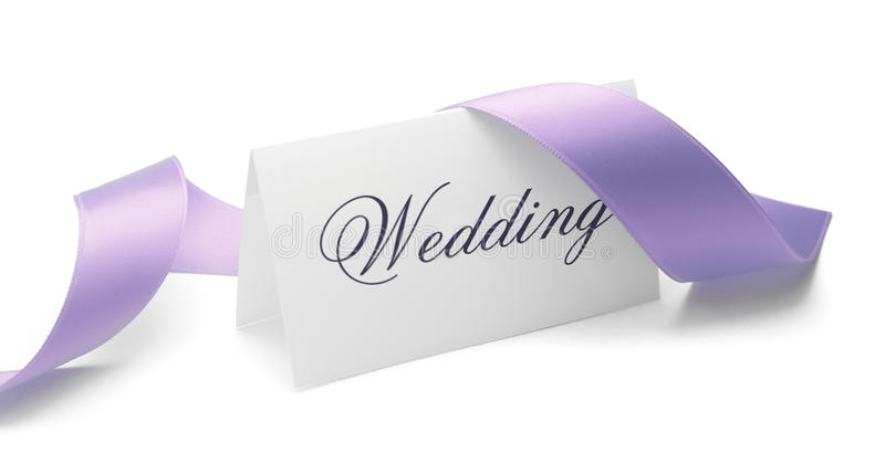 Wedding. Card and purple ribbon over a white background stock photos