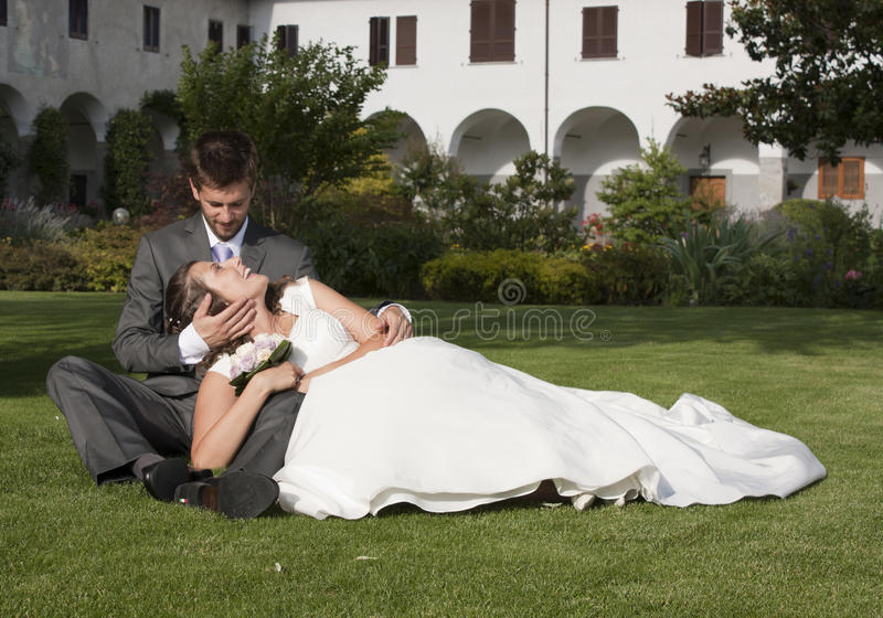 Wedding. Pictures, the couple in a garden royalty free stock images