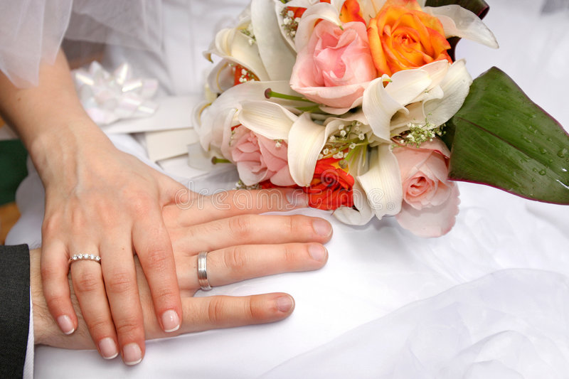 Wedding. Hand by hand royalty free stock images