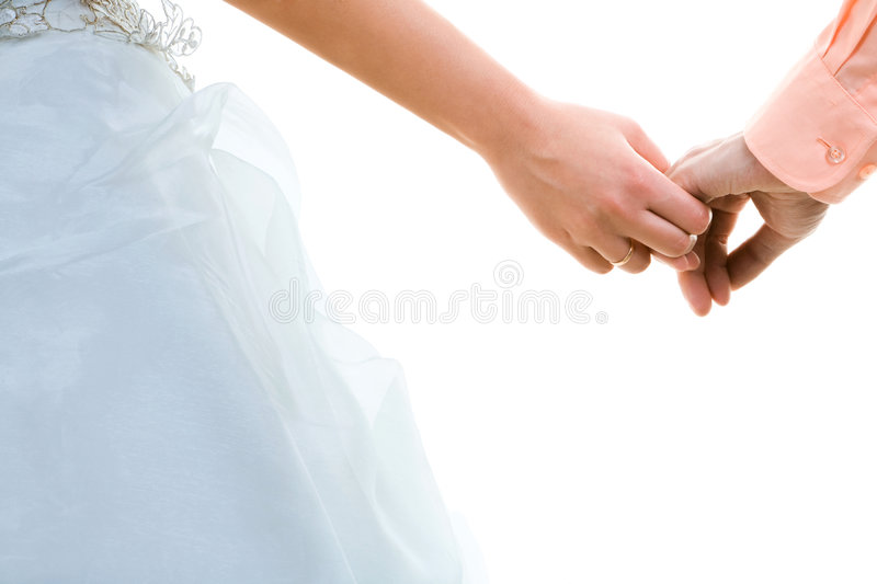 Wedding. Photo of married couple holding hands stock images