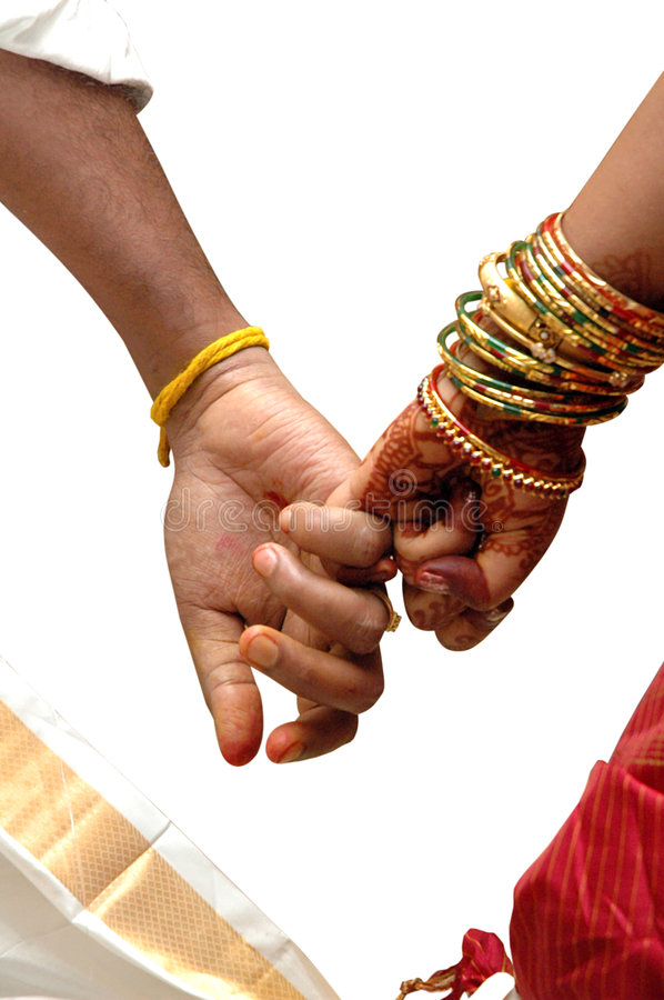 Wedding. Joint hands of just married hindu couple with clipping path