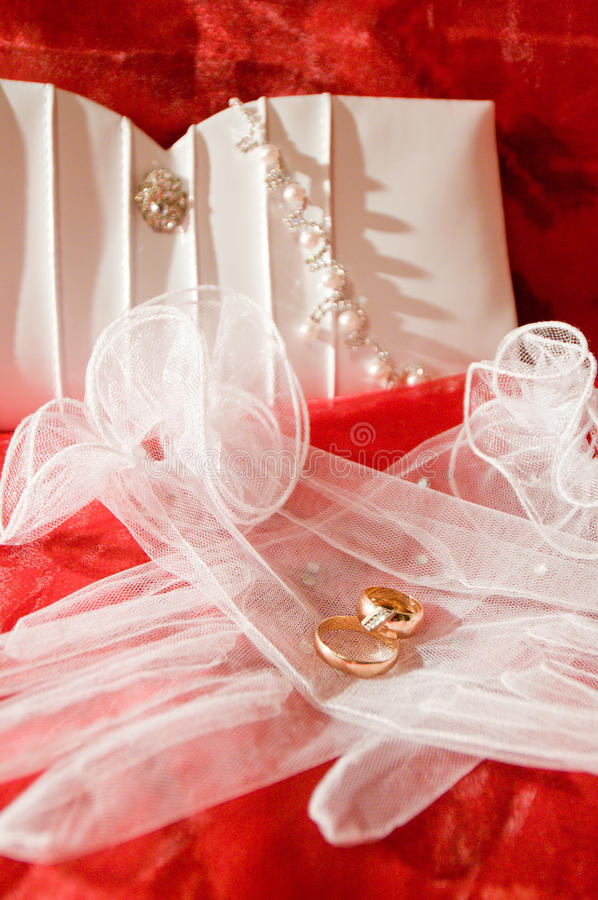 Wedding accessories. Stylish wedding accessories with two gold rings stock photos
