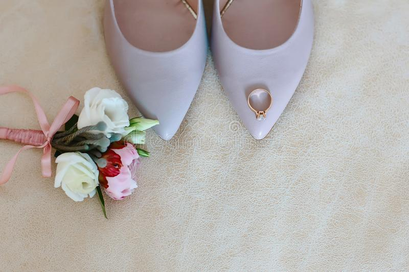 Wedding accessories, bouquet, shoes and ring bridal, wedding details. Top view with copy space.  royalty free stock photo