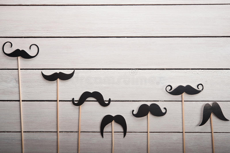 Wedding accessories set moustache. On white table royalty free stock images