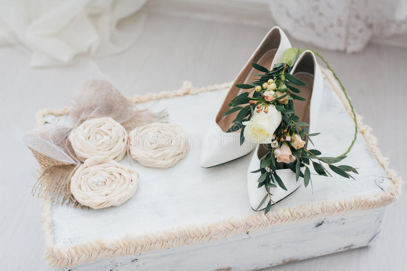 Wedding accessories. Shoes, wreath and bouquet of the bride stock photo